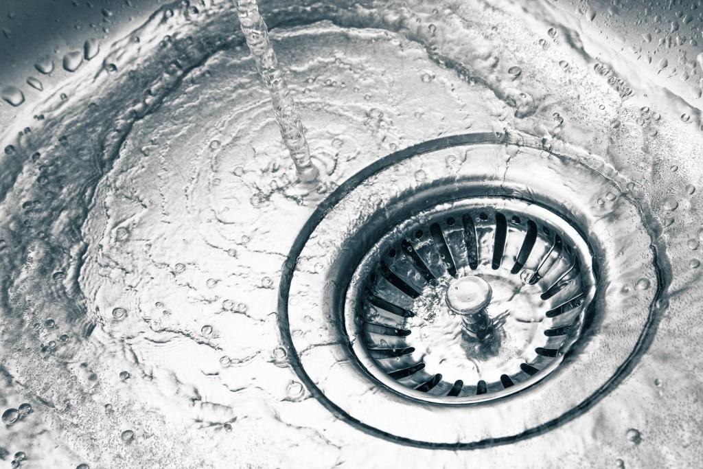 a stainless steel kitchen sink drain detail
